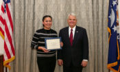 The U.S. Ambassador presents a certificate to intern Izabela Chalupníková