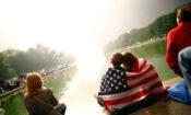 People watch fireworks during the 4th of July Independence Day celebrations at the National Mall in Washington, U.S.