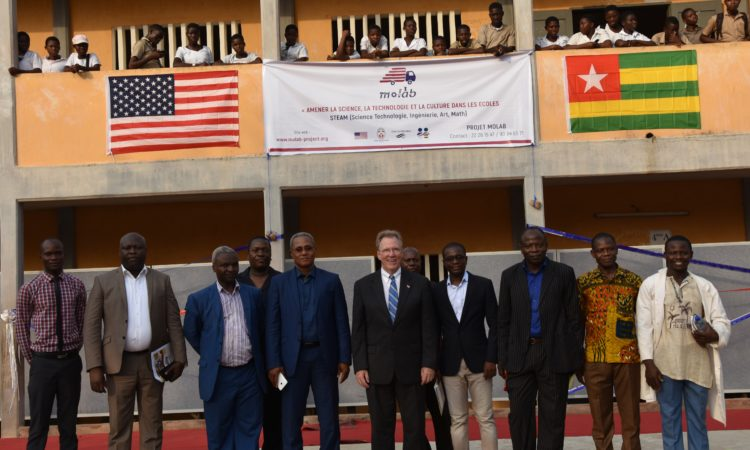 Ambassador David Gilmour posing with education officials