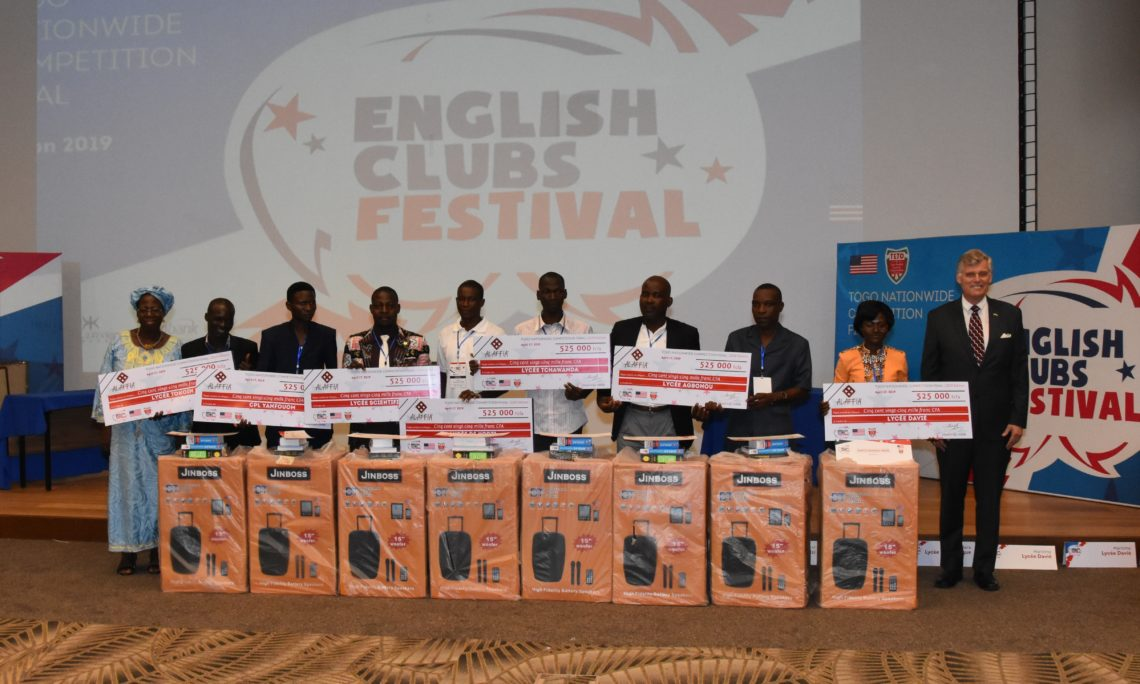 English Club coaches pose with ALAFFIA representative on the left and Ambassador Eric W. Stromayer on the right