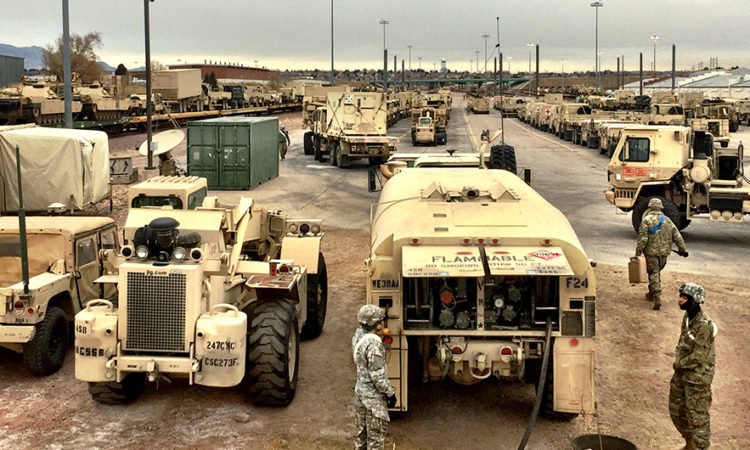 Soldiers with 68th Combat Sustainment Support Battalion, 4th Sustainment Brigade, 4th Infantry Division, provide fuel to vehicles from 3rd Armored Brigade Combat Team, 4th Inf. Div., during rail-load operations at Fort Carson, Colorado, Dec. 2, 2016. (Photo by Capt. Scott Walters)