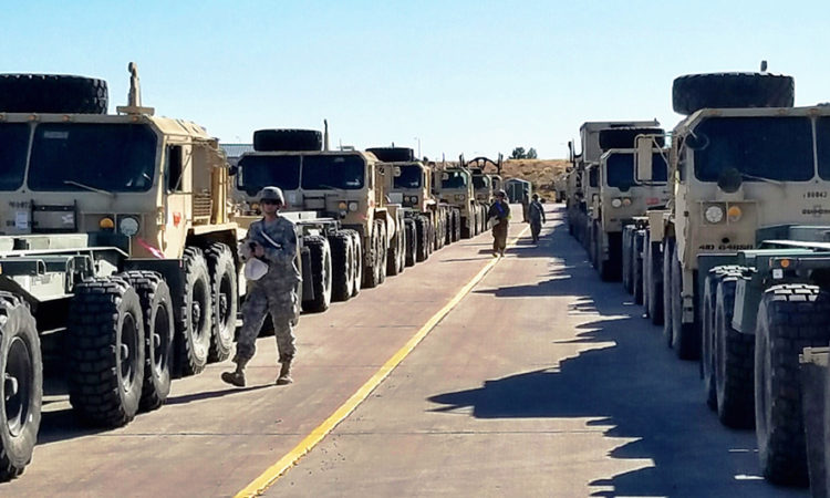 Soldiers from 64th Brigade Support Battalion, 3rd Armored Brigade Combat Team, 4th Infantry Division, stage tactical vehicles for loading on to trains at Fort Carson, Colorado, Nov. 7, 2016. (Photo Credit: U.S. Army photo by Staff Sgt. Ange Desinor, 3rd ABCT Public Affairs, 4th Inf. Div.)