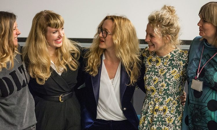 Amy Karle (second from left) shared a warm moment with new Polish colleagues after her Artist's Talk at Copernicus Science Center on April 26 (photo: Kacper Bartczak / Grain Films)