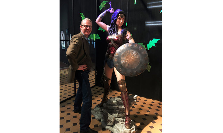 "Cultural Affairs Officer Dan Hastings with Wonder Woman at the September 27 opening of DC Comic's ""Dawn of the Superheroes"" Exhibition at EC1 in the Polish City of Łódż"