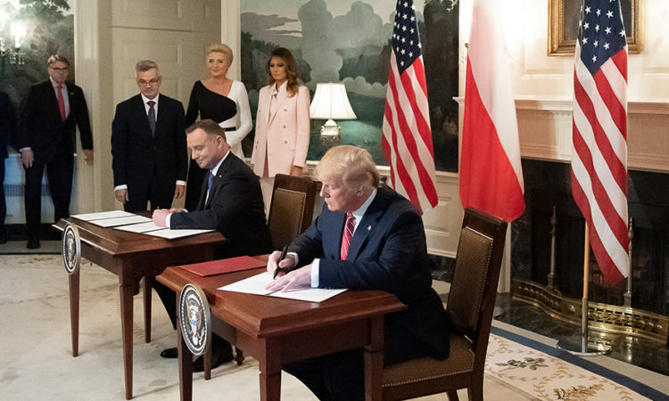 President Donald J. Trump and Polish President Andrzej Duda sign a joint declaration Wednesday, June 12, 2019, as First Lady Melania Trump and Mrs. Agata Kornhauser-Duda, wife of President Duda, look on in the Diplomatic Reception Room of the White House. (Official White House Photo by Andrea Hanks)
