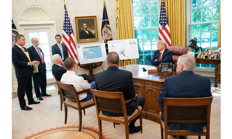 President Donald J. Trump, joined by Vice President Mike Pence, receives a briefing on Hurricane Dorian as it approaches the U.S. mainland Thursday, Aug. 29, 2019, in the Oval Office of the White House. (Official White House Photo by Shealah Craighead)