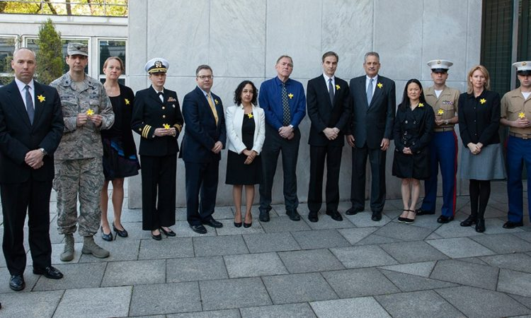 Ambassador Jones and U.S. Embassy personnel wear paper daffodils to commemorate the 75th anniversary of the Warsaw Ghetto Uprising.
