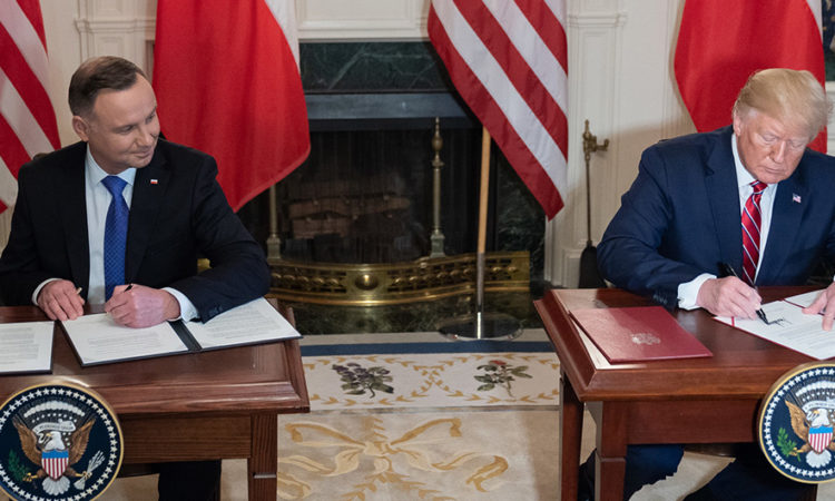 President Donald J. Trump and Polish President Andrzej Duda Polish President Andrzej Duda sign a joint declaration Wednesday, June 12, 2019, in the Diplomatic Reception Room of the White House. (Official White House Photo by Shealah Craighead)