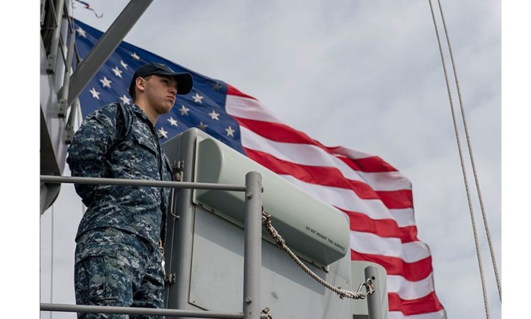 GDYNIA, Poland (June 24, 2018) Cryptologic Technician (Technical) Seaman Apprentice Ashton Corr mans the rails of the Harpers Ferry-class dock landing ship USS Oak Hill (LSD 51).tions. (U.S. Navy photo by Mass Communication Specialist 3rd Class Michael H. Lehman/Released)