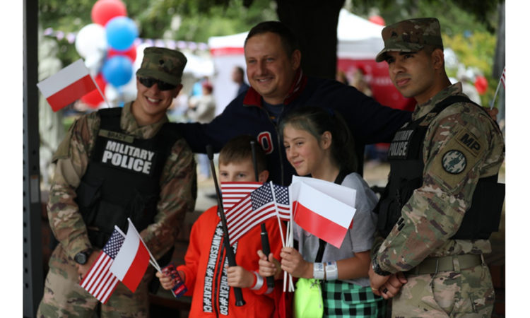 U.S. Soldiers interact with people of all ages and cultural background during the Freedom Festival in Warsaw. (Photo by Sgt. Kyle Larsen, 5th Mobile Public Affairs Detachment)