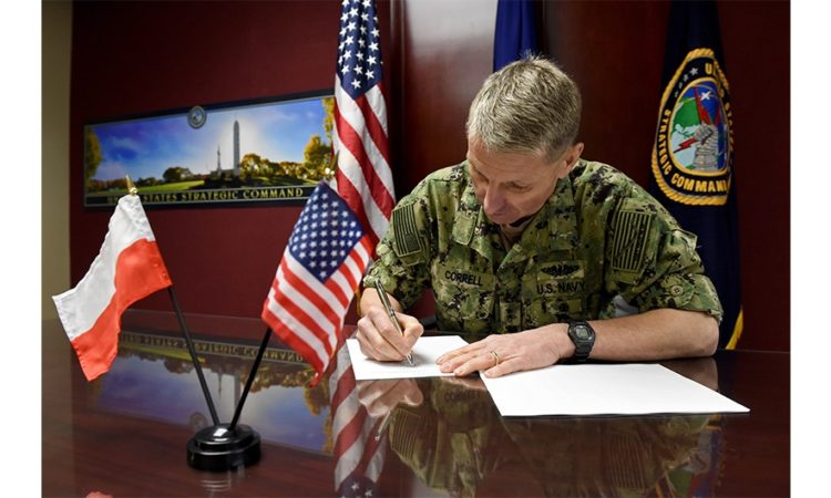 U.S. Navy Rear Adm. Richard Correll, U.S. Strategic Command (USSTRATCOM) director of plans and policy, signs an agreement to share space situational awareness (SSA) services and information with the Polish Space Agency at USSTRATCOM headquarters on Offutt Air Force Base, Neb., April 4, 2019. Correll signed the agreement as part of a larger effort to support spaceflight planning and enhance the safety, stability and sustainability of space operations. Poland joins 18 nations, two intergovernmental organizations, and 77 commercial satellite owners, operators, launchers already participating in SSA data-sharing agreements with USSTRATCOM. (Photo by Staff Sgt. Ian Hoachlander)