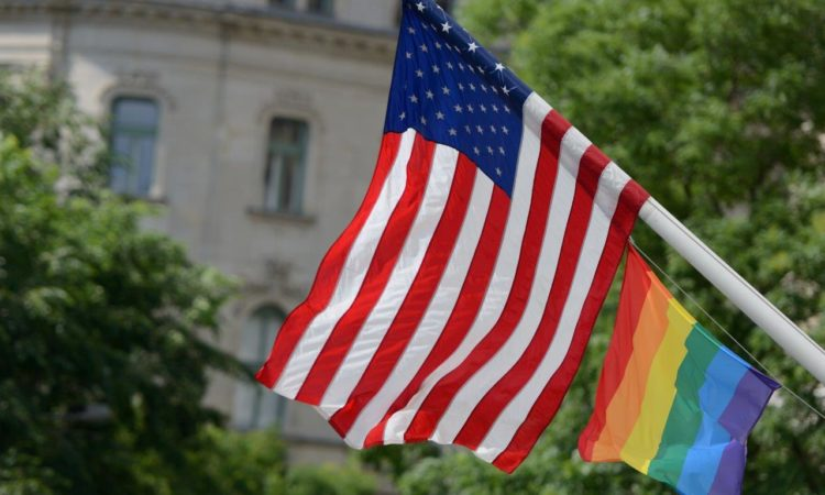 rainbow flag and American flag