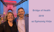 Deputy Chief of Mission Marc Dillard and his wife walk across Chain Bridge. Text: Bridge of Health 2019 (Embassy photo)