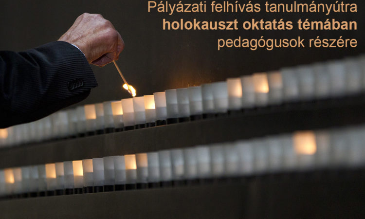 Hand shown lighting a candle (AP Images)