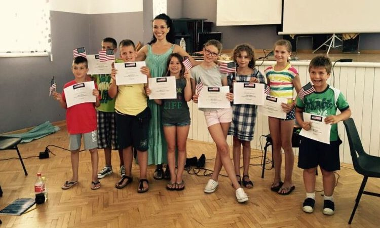 Kids holding their certificates (State Dept.)