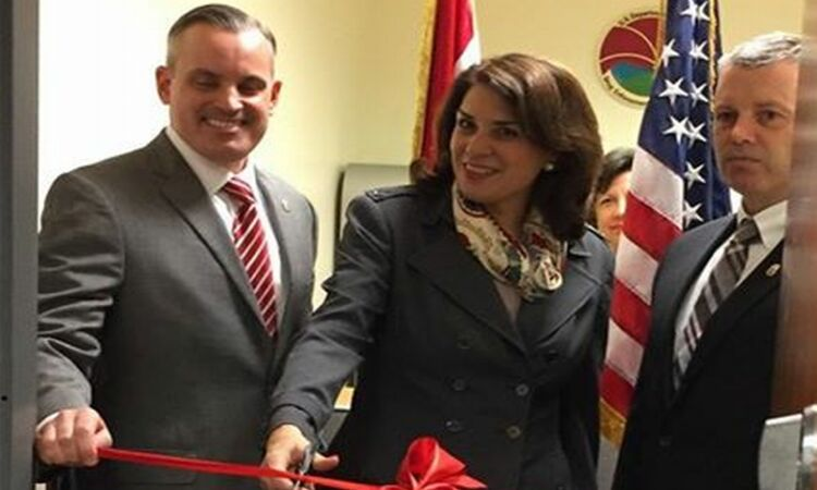 Ambassador cuts the red ribbon on opening ceremony [State Dept.]