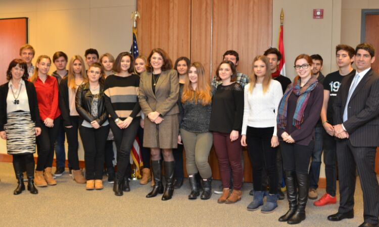 The Ambassador surrounded by students [State Dept.]