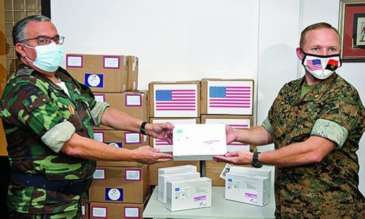 Two military men holding test kits. (Embassy Image)