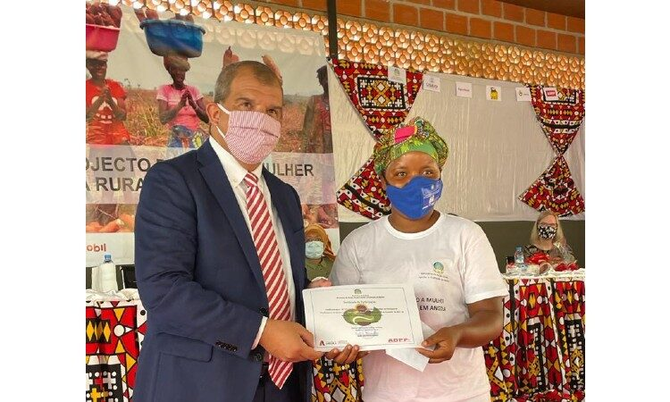 Man and woman holding certificate. (Embassy Image)