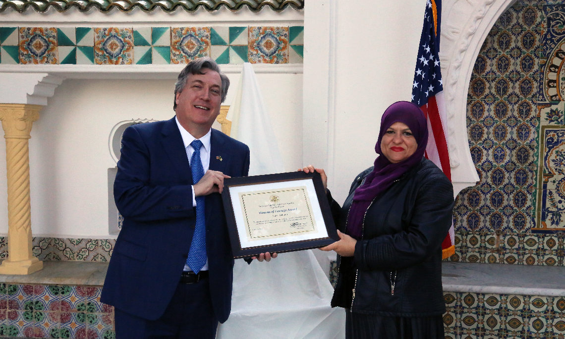 "HE. Ambassador John Desrocher presentsthe ""Algerian Woman of Courage"" award to Nawel Bahlouli Ptesident of El Hayet Association"