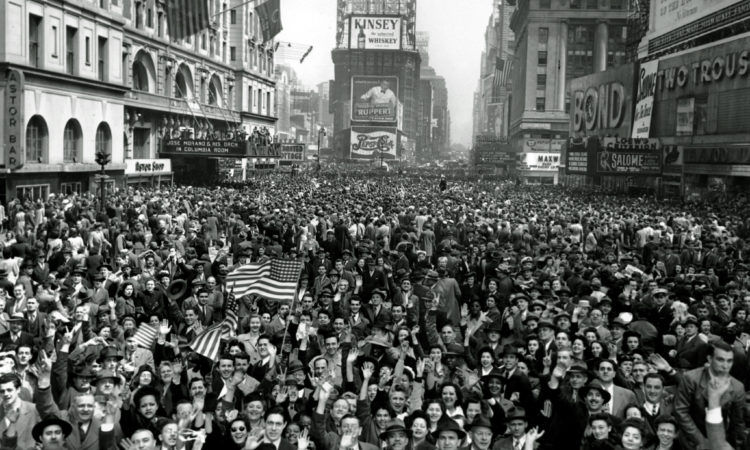 Looking north from 44th Street, New York's Times Square is packed Monday, May 7, 1945, with crowds celebrating the news of Germany's unconditional surrender in World War II. (AP Photo/Tom Fitzsimmons)