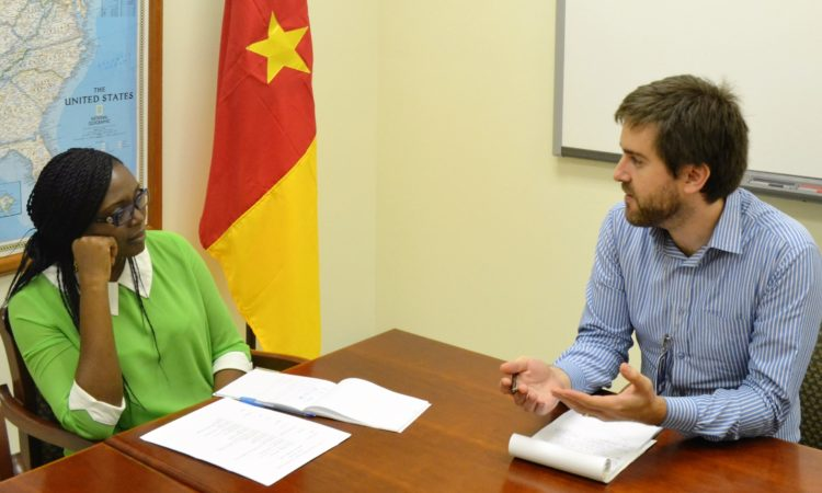 Cultural Affairs Officer Will Romine discusses with Dr. Babette Koultchoumi before her departure to the U.S. [USEYde Photo]