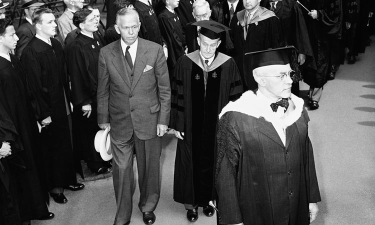 Secretary of State George Marshall joins in a procession before speaking at Harvard University on June 5, 1947. (© AP Images)