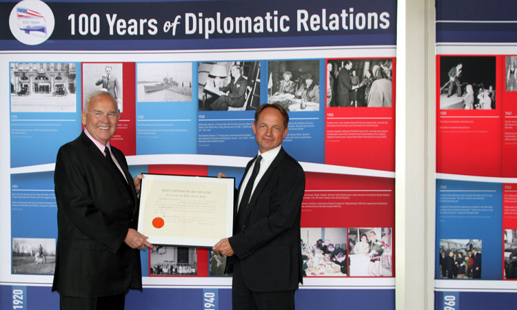 Ambassador Pence receives donation of diplomatic artifact (© State Dept.)