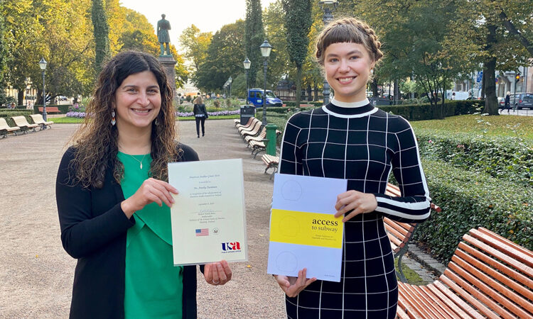 Deputy Public Affairs Officer Nazanin Berarpour congratulates Annika Tuominen, the American Studies Grant 2019 winner. (© State Department)