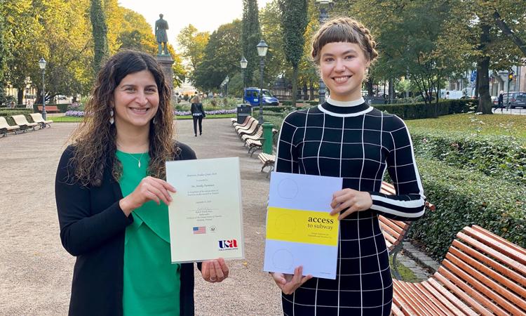 Deputy Public Affairs Officer Nazanin Berarpour congratulates Annika Tuominen, the American Studies Grant 2019 winner. (© State Department)