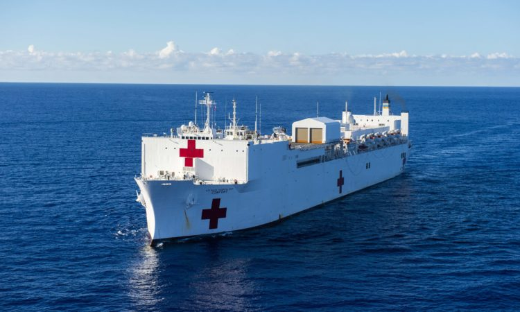 The hospital ship USNS Comfort (T-AH 20) transits south on an 11-week