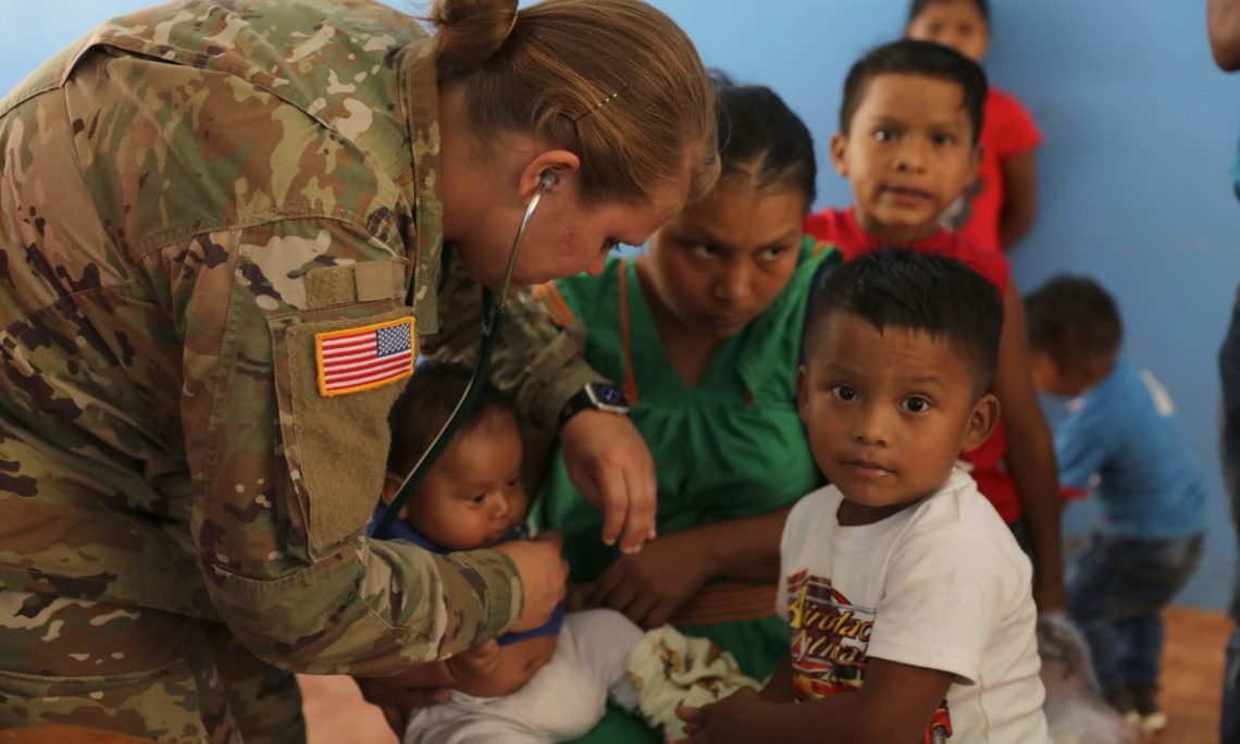 M.D. Keyly Knechtel from Joint Task Force Bravo gives medical consultation to the Santos Medrano Family