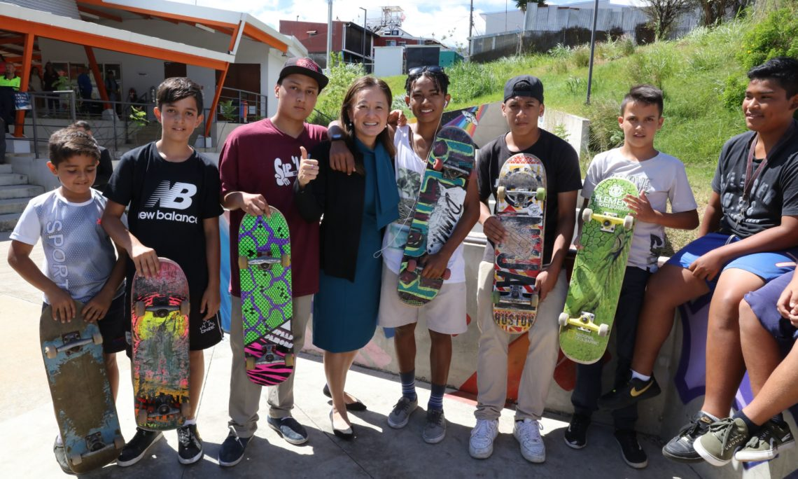 Principal Deputy Assistance Secretary Julie Chung with young people from the Desamparados