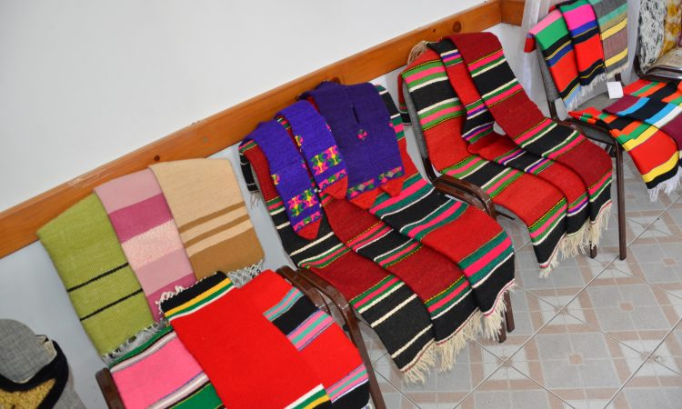 Red rugs on chairs