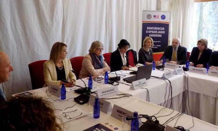 Ambassador Uyehara sitting at the conference table with Representatives of Judiciary