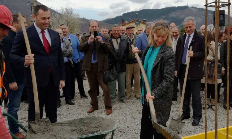A men and a woman with shovels in a ceremony of constructions start