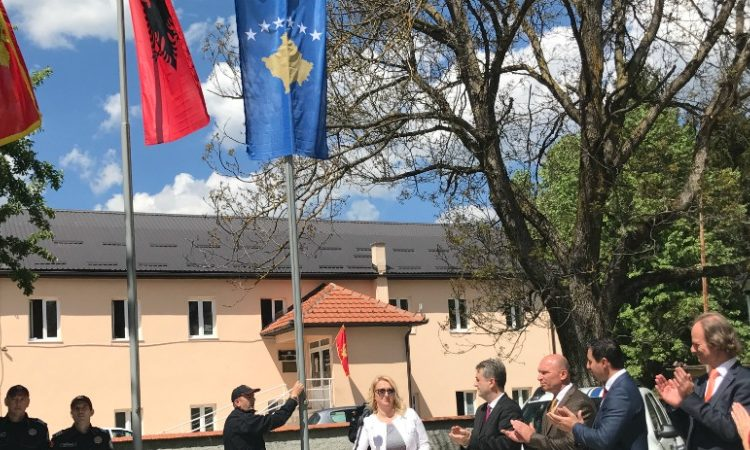 Montenegro, Albania and Kosovo flags raising in front of a building