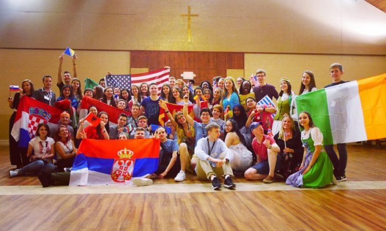 Group of students with flags of different countries