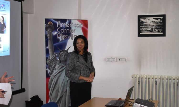 A woman in front of a American Corner back drop