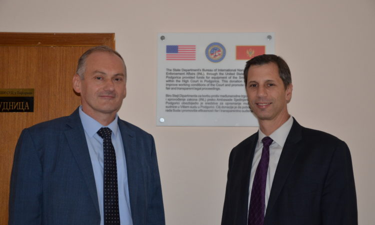 Two men in front of a US donation board