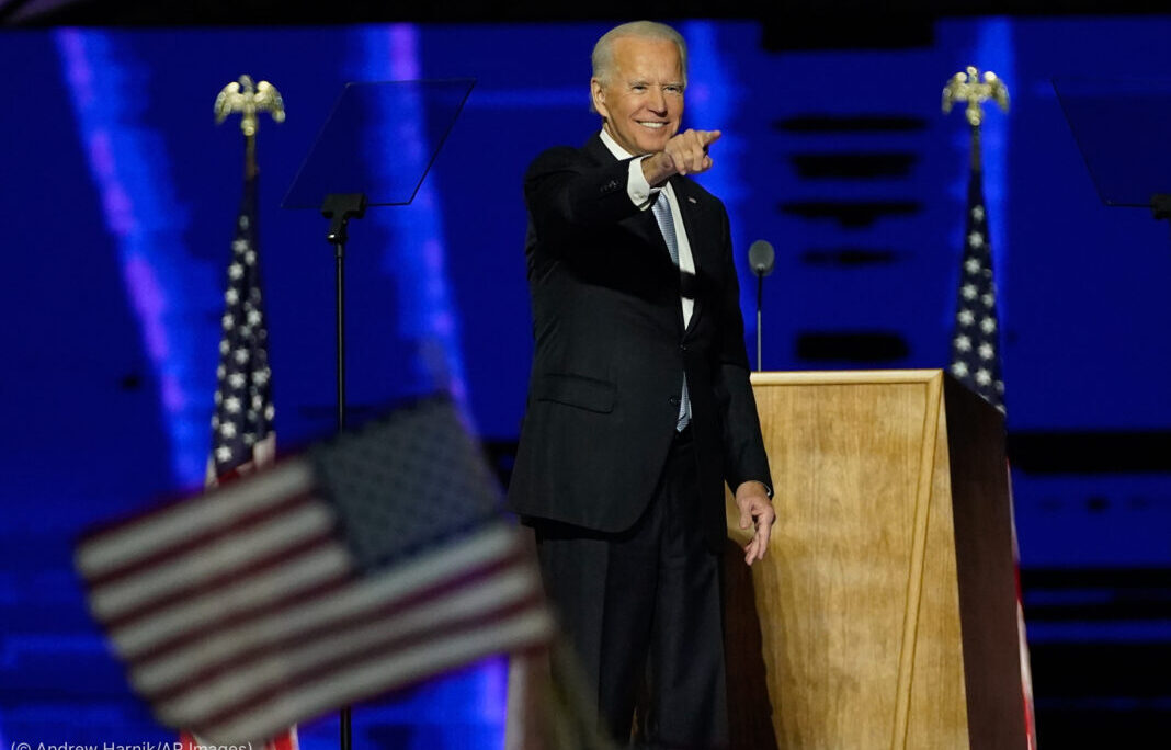 President-elect Joe Biden gestures on stage after speaking, Saturday, Nov. 7, 2020, in Wilmington, Del. (AP Photo/Andrew Harnik, Pool)