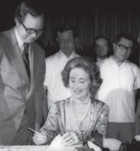 Secretary of Commerce Juanita Kreps signs documents at the Canton Trade Fair, 1979 (AP Images)