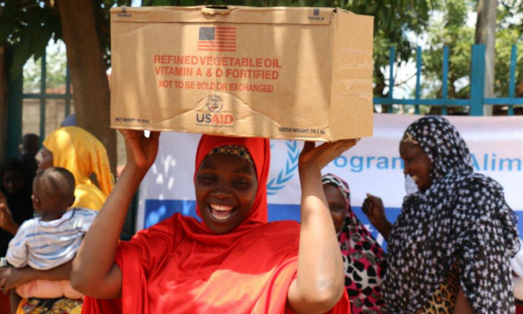 Lady carrying box. (Embassy Image)