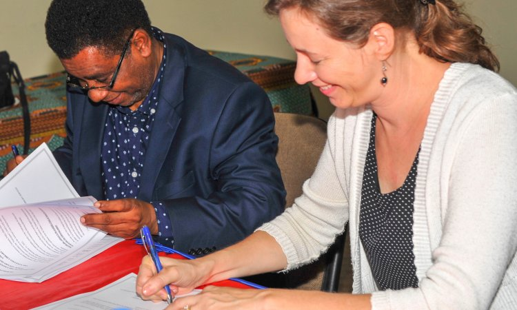 U.S. Embassy Public Affair Officer, Marissa Maurer, and Director General of the Tanzania Library Services Board, Dr. Alli Mcharazo, sign a Memorandum of Understanding.