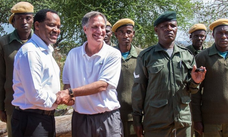 U.S. Ambassador Mark Childress and Natural Resources and Tourism Minister Lazaro Nyalandu shake hands at the launch of the PROTECT project, which took place yesterday at the Treetops Lodge in the Randilen Wildlife Management Area (Photo:U.S. Embassy, Dsm)