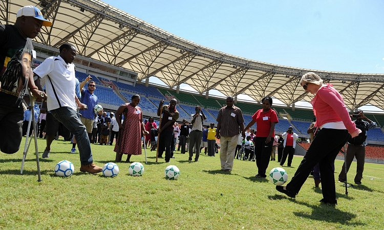 Deputy Chief of Mission Virginia M. Blaser shows off her juggling skills with a group of athletes with disabilities at the inauguration of a sports for disability workshop organized by the University of Kentucky and the Tanzanian Paralympic Committee.