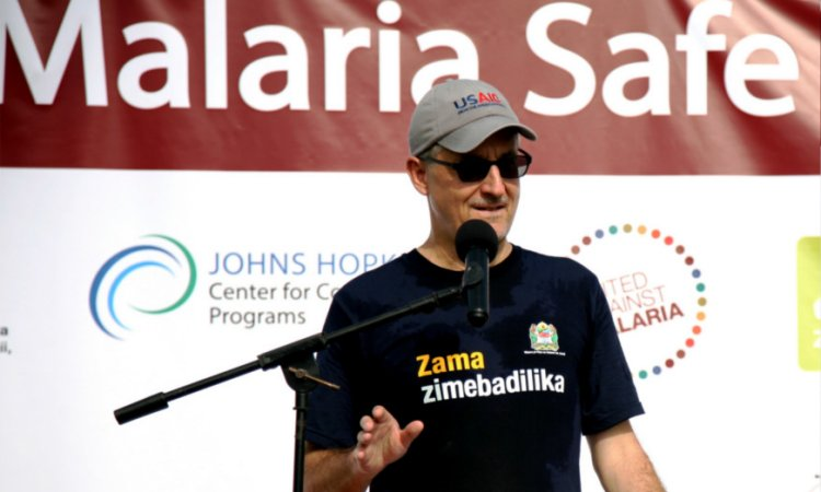 "USAID Director Daniel Moore offers remarks at the conclusion of a 5-kilometer ""Malaria Safe Walk."" (Photo: U.S. Embassy Dar es Salaam)"