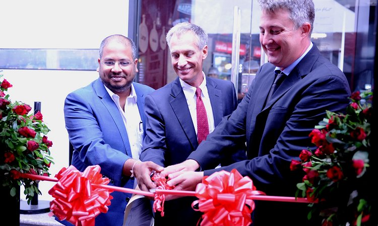Ambassador Mark Childress (center) Pizza Hut Africa General Manager, Randall Blackford (right) and the Director of Dough Works Ltd, Mr. Vikram Desai cut a ribbon to officially inaugurate Pizza Hut restaurant in Dar es Salaam.