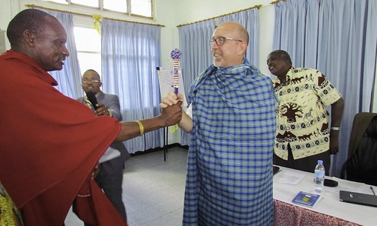 A custom beaded Maasai rungu stick and Maasai cloth, presented to USAID Deputy Office Director for Economic Growth Randy Chester by Chairman of Enduimet WMA Komolo Simel