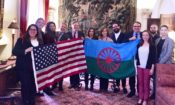 Group with US and Roma flag